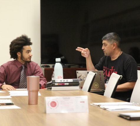ASG Vice President Armando Garcia, Right, points to clarify to President DeRon Walker, left, at their weekly meeting on Tuesday, Oct. 22, 2019 in the FCC Senate Chambers.