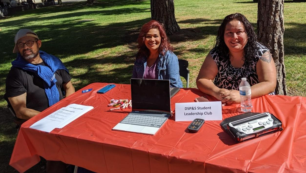 The new DSP&S club advertised the gear available to disabled students including a Google pixel for class. Pictured from left to right: club member Luis Santa, club member Matilda Woodard, and club president Veronica Hernandez.