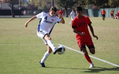 Sophomore midfielder Alex Echevierra racing for an attack on goal against West Hills Lemoore defender Pete Hawken on Tuesday, Nov. 5, 2019