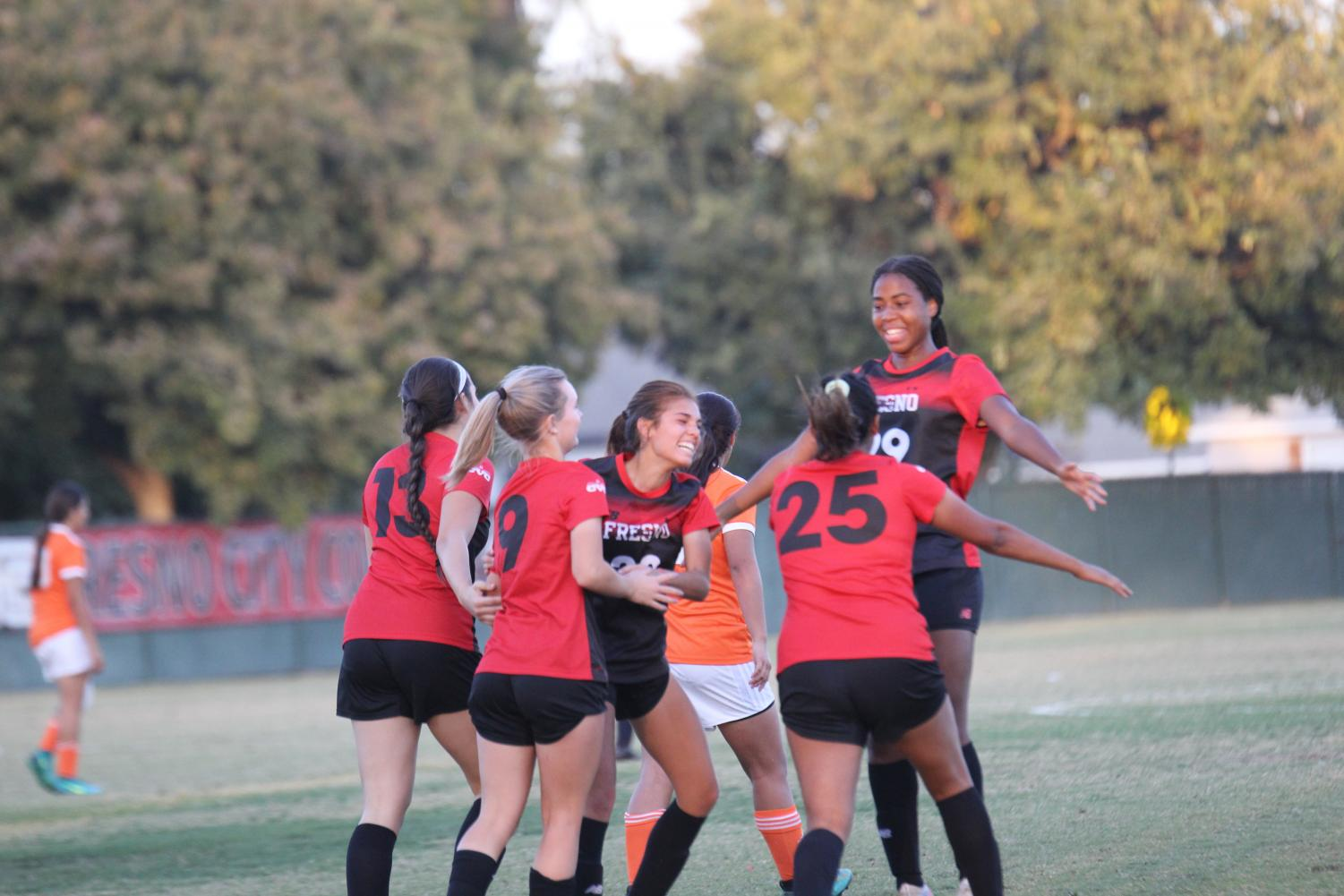 The Rams celebrate a goal during their 4-2 win over conference rival Reedley College during their match on Tuesday, Nov. 5, 2019