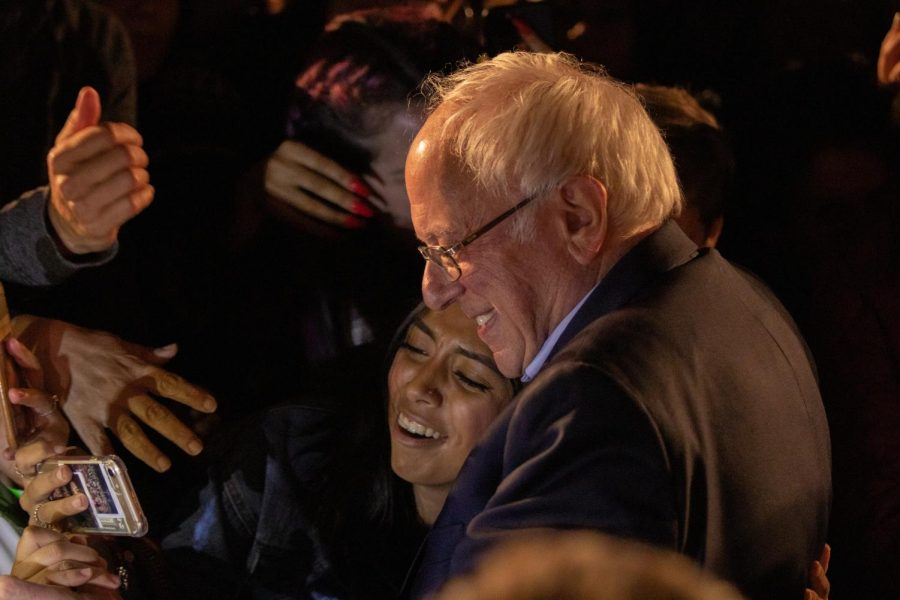 Presidential hopeful Sen. Bernie Sanders poses for a selfie with a supporter, Friday, Nov. 15, 2019. Sanders hosted a Green New Deal rally at Fresno City College.