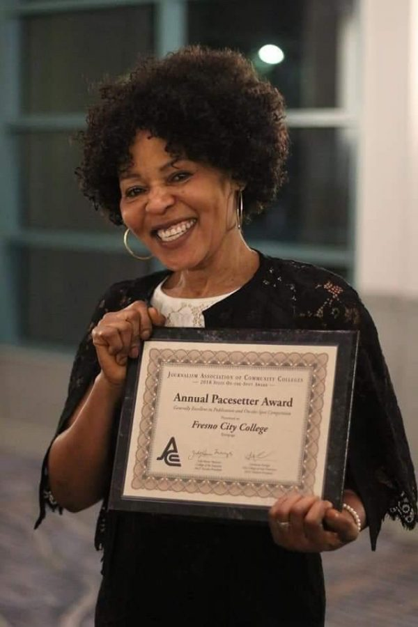 Dympna Ugwu-Oju, Rampage adviser, holding an annual pacesetter award from the Journalism Association of Community Colleges. During her tenure as adviser, the Rampage has taken this award home several times.