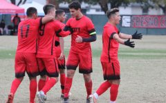 Mason Gonzalez celebrates with his fellow teammates after scoring the lone goal for the Rams during their 1-0 win over the San Joaquin Delta Mustangs on Saturday, Nov. 30. The goal propelled the Rams to the semifinals round for the 2019 CCCAA State Championship.