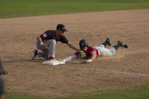 Freshman third baseman Evan Rocha tags the runner out to end the top of the sixth inning in the Rams