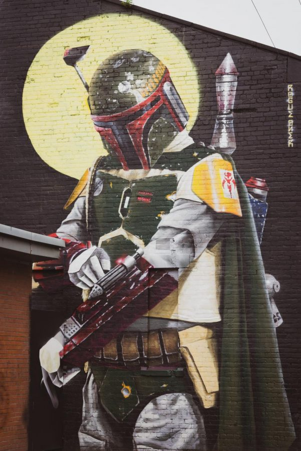 A mural of Boba Fett, a Mandalorian bounty hunter known from Star Wars. Other Mandalorians are the focus of a widely popular TV series on Disney +.