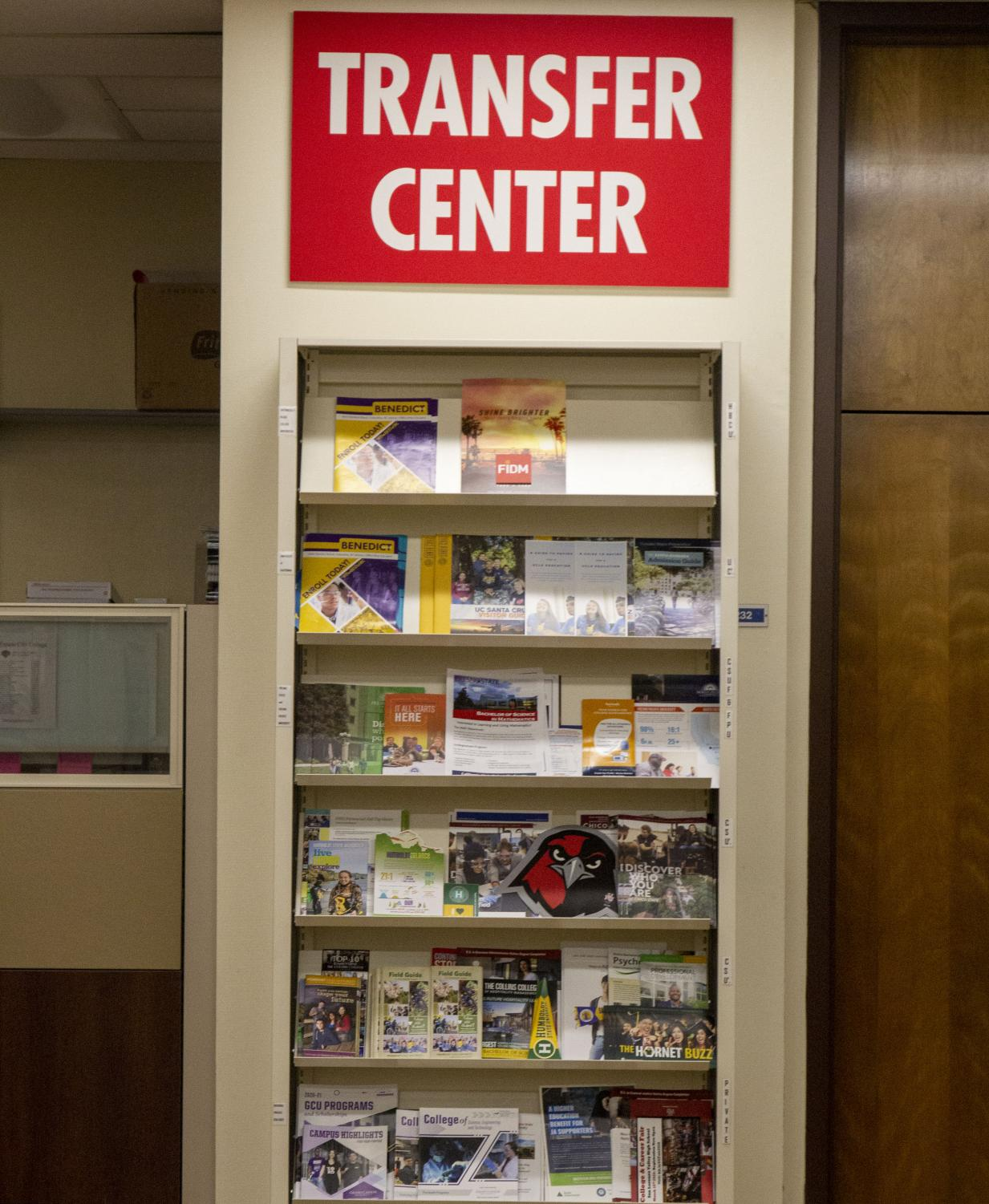Information pamphlets and flyers sit at the Transfer Center on Tuesday, Feb. 11. The Transfer Center is located in the Student Services Building in ST-200