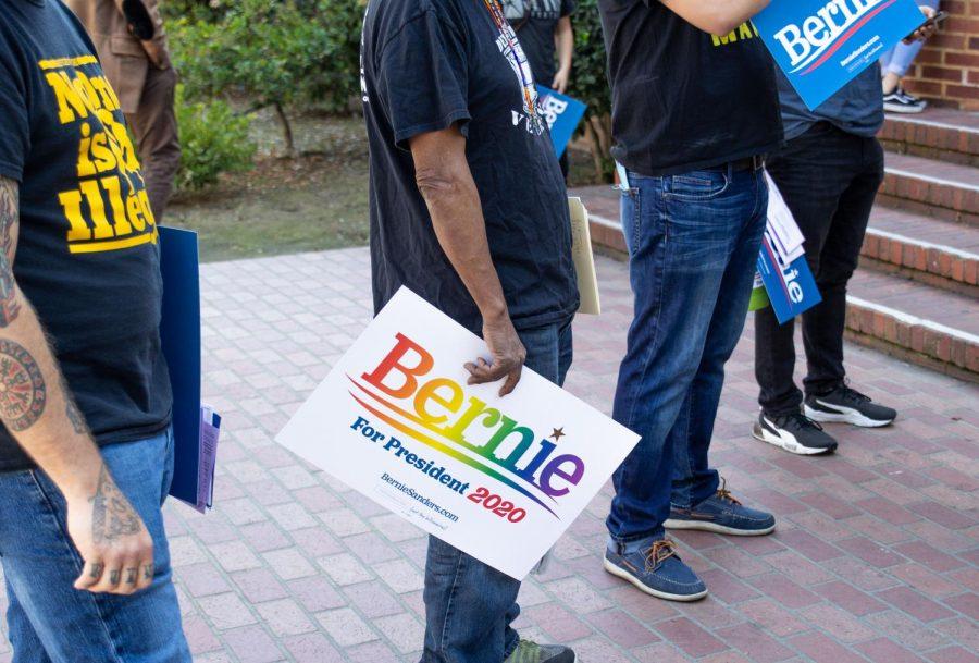 A Bernie Sanders supporter holds a rainbow