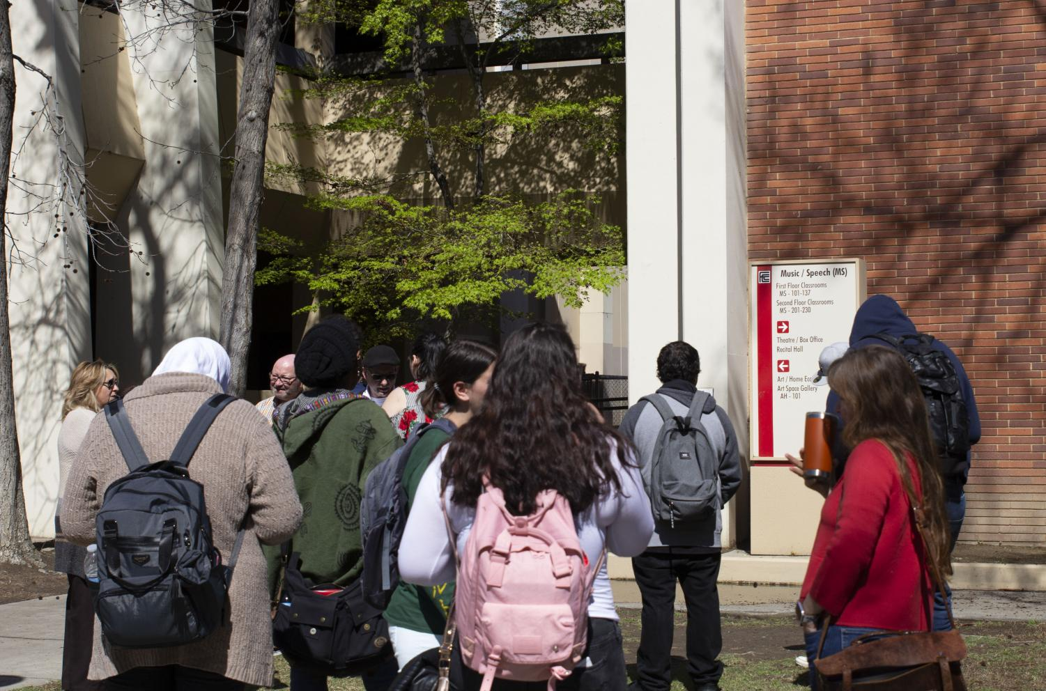 Faculty+and+students+gather+outside+the+Music%2FSpeech+building+following+a+potential+gas+leak+which+prompted+an+evacuation+shortly+after+noon+on+Wednesday%2C+March+13.